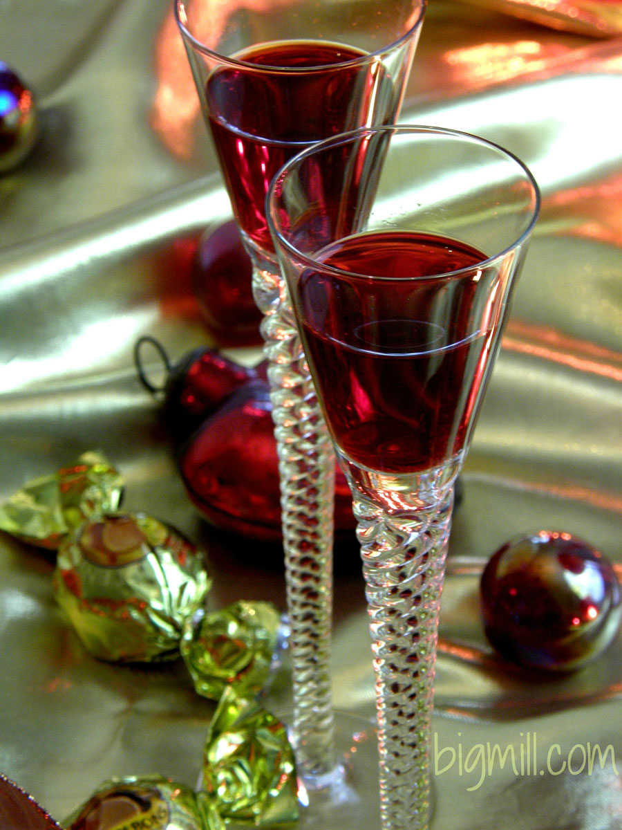 Festive, colorful Homemade Cranberry Liqueur is a hit at all your holiday parties. Recipe from Chloe at Big Mill | bigmill.com